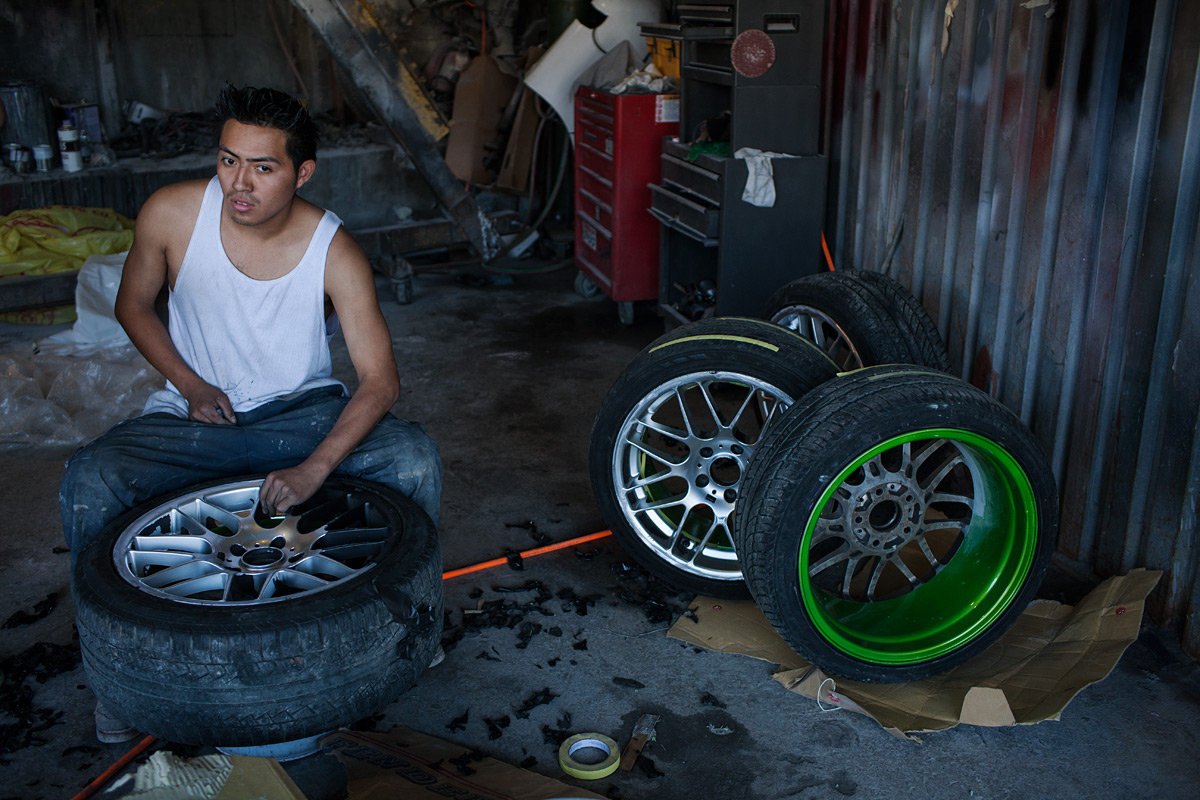 Painting Rims. Willets Point, Corona, NY.